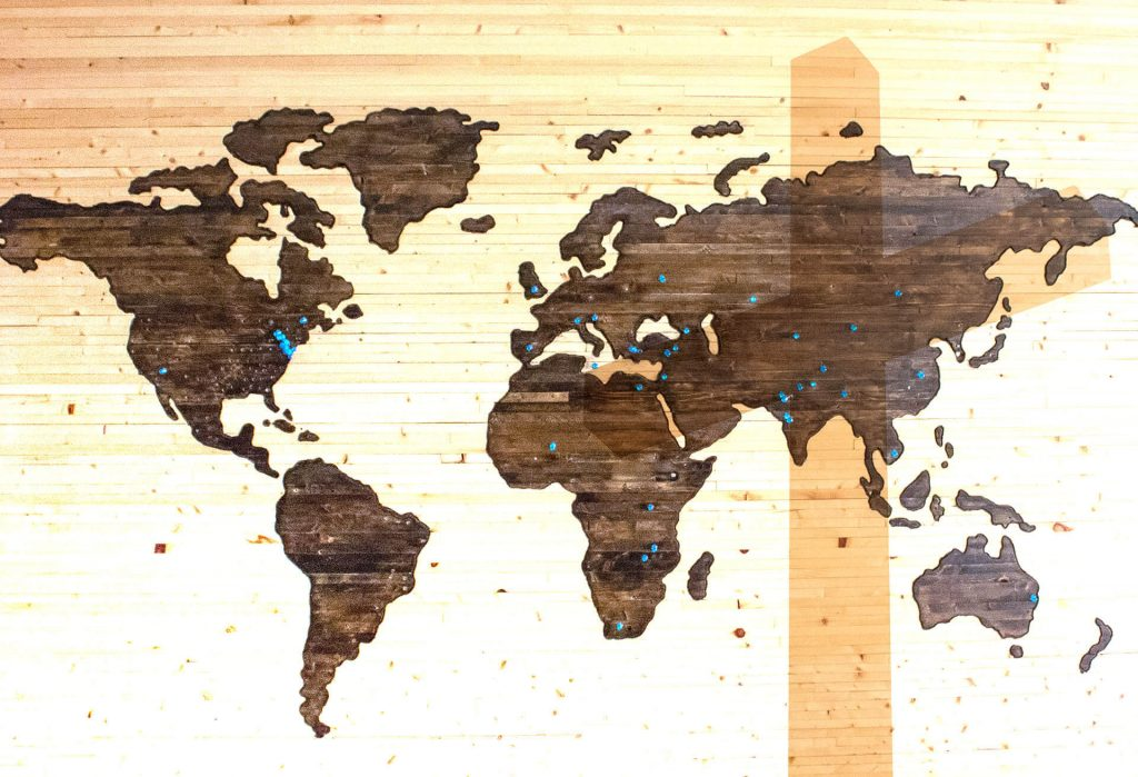 world map and cross